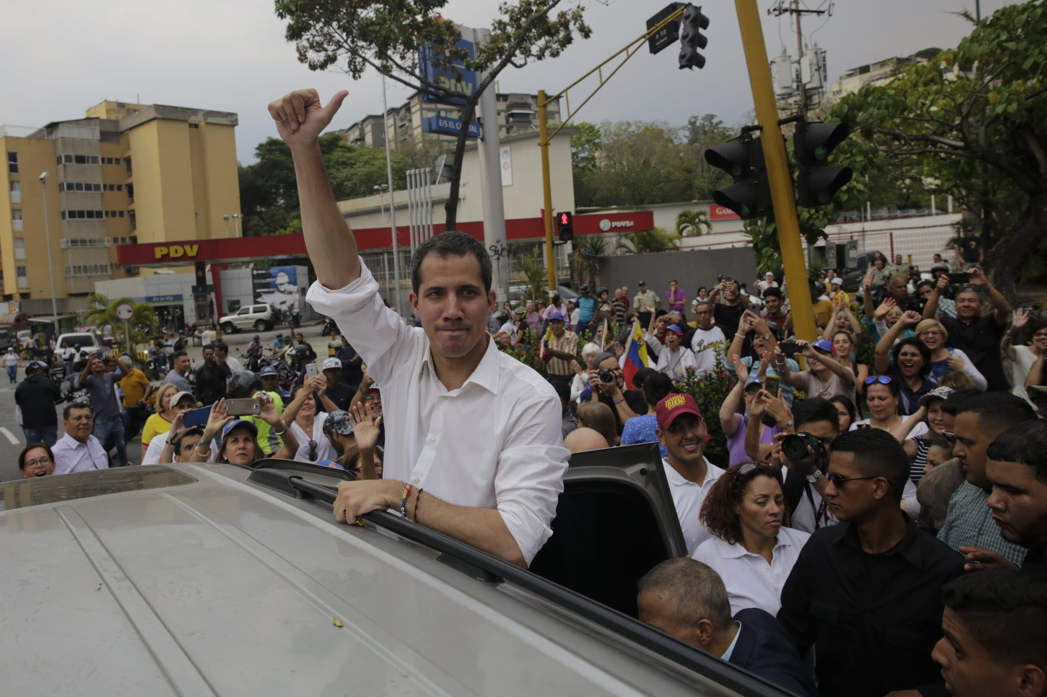 CARACAS, VENEZUELA - APRIL 10: Venezuelan opposition leader Juan Guaido, recognized by many members of the international community as the country's rightful interim ruler, greets people during a rally on April 10, 2019 in Caracas, Venezuela. During his speech at the Security Council of UN today, Vice President of United States Mike Pence asked UN to revoke the credentials of Venezuelaís ambassador to the UN and  recognize Guaido as interim President. (Photo by Marco Bello/Getty Images)