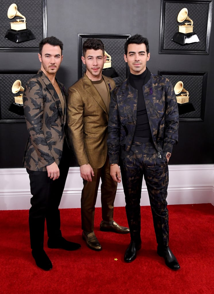 "The Jonas Brothers had the support of their respective wives as they attended the Grammys on Sunday night. The group, who was up for best pop duo/group performance for ""Sucker,"" looked super dapper in looks by Ermenegildo Zegna XXX as they hit the red carpet together. Nick Jonas and Priyanka Chopra wore shimmery ensembles, Joe Jonas and Sophie Turner rocked darker shades, and Kevin and Danielle Jonas mixed and matched with gold and silver looks. The brothers also sported purple ribbons, which were reportedly in honor of former NBA star Kobe Bryant, who died in a helicopter crash on Sunday.  The brothers also hit the Grammys stage for the first time in over a decade. In addition to performing ""What a Man Gotta Do,"" they also sang a new song titled ""Five More Minutes."" During a Shazam video, the brothers revealed that the new songs would be part of a ""forthcoming album."" Yes, that means we have even more new Jonas Brothers music in store! See more pictures of their appearance ahead.      Related:                                                                                                           Billie Eilish, Lizzo, Lil Nas X, and Everyone Else Who Took Home a Grammy This Year"