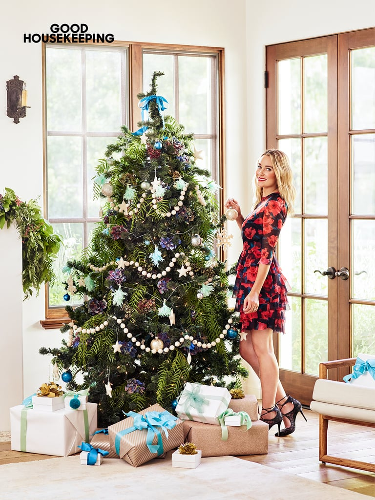 Lauren keeps her tree looking chic by sticking with a clean blue and green palette. Packages wrapped in neutral white and brown paper keep the look clean and make the entire living room look festive long before Christmas Day.