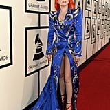 Attending the 2016 Grammys wearing a David Bowie-inspired dress from Marc Jacobs.