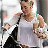 Miley Cyrus wore her newly blond hair in a high bun.