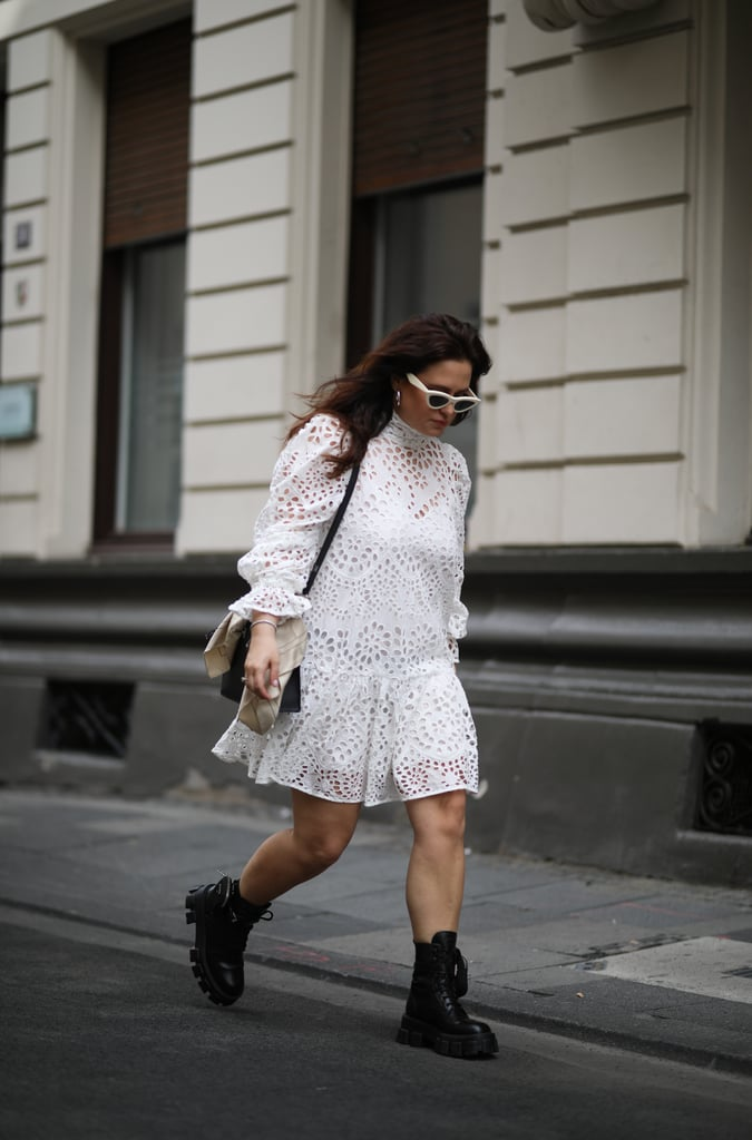 Contrast a white lace, puff-sleeve dress with chunky black combat boots