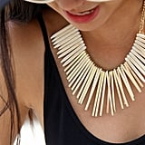This bold necklace from Akira took a basic black look to a new level.
