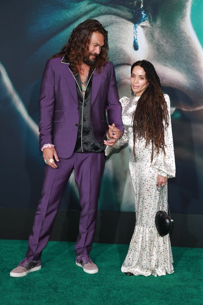Jason Momoa and Lisa Bonet looked like a million bucks at Joker's Los Angeles premiere on Saturday. The adorable duo hit the red carpet dressed to the nines as Jason sported a purple Joker-inspired suit and Lisa rocked a white floral gown with a heart-shaped purse. They walked to the venue hand in hand with Jason looking especially smitten as he gave his wife adorable heart eyes. The actor — who recently delivered a powerful UN speech about climate change — also had a bit of fun striking a few silly poses. Whenever these two hit the red carpet, you can expect some frame-worthy snapshots. Look ahead to view more pictures from their night at the premiere!      Related:                                                                                                           26 Times Jason Momoa and Lisa Bonet's Relationship Was Almost Too Cute to Handle