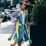 A linen colorblock dress, sturdy slides, and a top knot is effortless on a warm day.