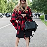 Keep the fact you're wearing a basic little black dress altogether hidden by belting a buffalo plaid poncho on top.