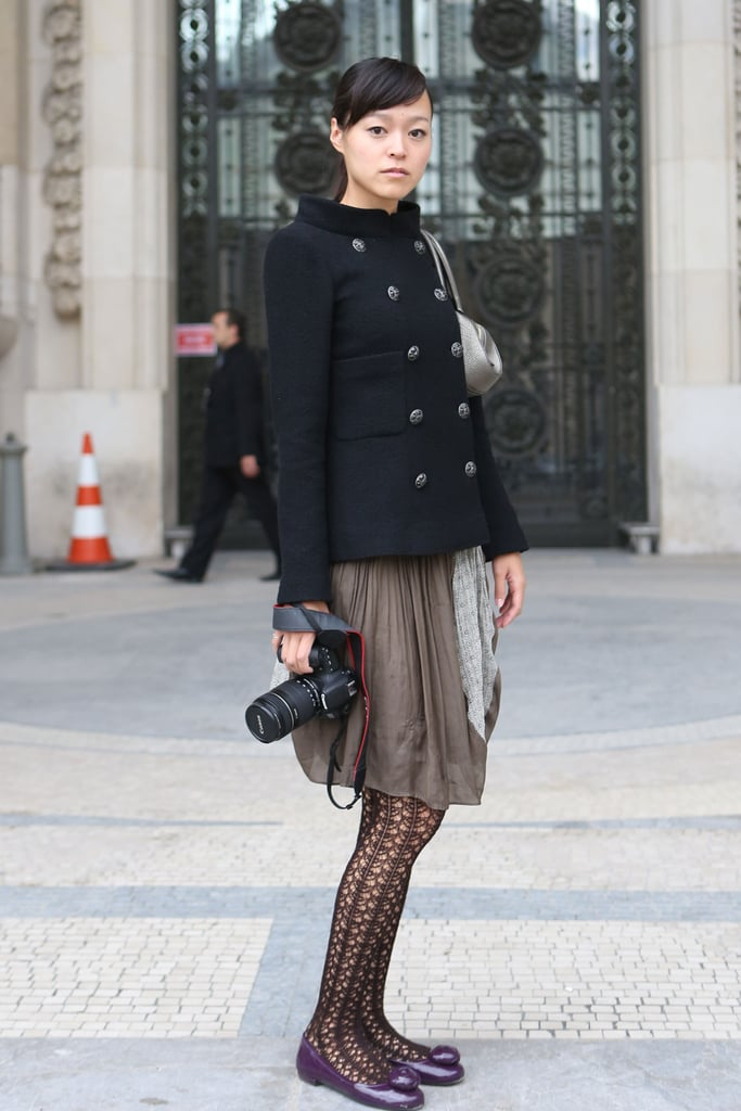 A structured peacoat tempered a breezy skirt and lacy tights.
