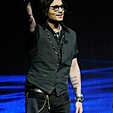 Johnny Depp waved to the crowd at CinemaCon in Las Vegas.