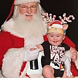 """River Rose hangin' with Santa Claus for the first time! She LOVED him ha!"""