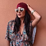 A turban, cat-eye sunglasses, and a bunch of bangles: the perfect getaway look.