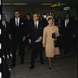 Princess Margaret and Lord Snowden stroll through the airport in NYC.