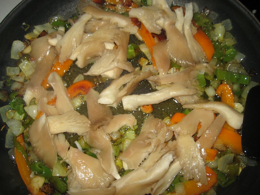 Once the sofrito has had plenty of time to cook, mushrooms are added to the pan.