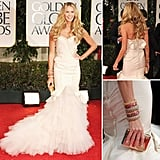 Elle Macpherson may just be aging backwards. The supermodel stunner arrived at the Golden Globes showing off her enviable figure in a body-hugging Zac Posen gown.