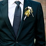 Use shiny noisemakers as boutonnieres to deck out the groomsmen.