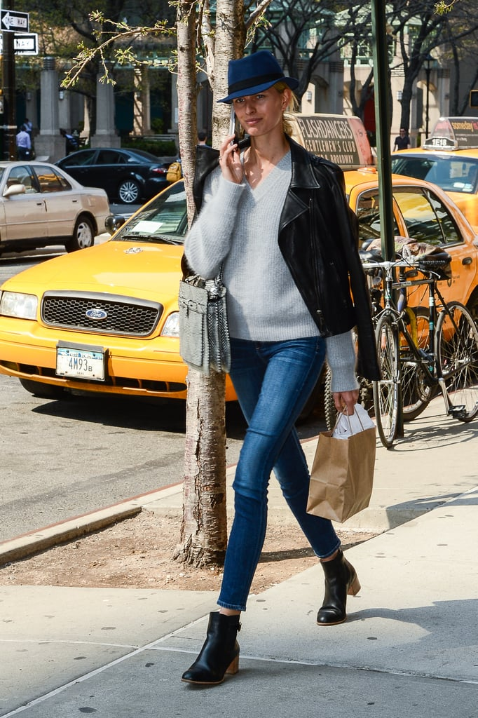 Karolina Kurkova strutted her svelte stuff down the streets of NYC sporting skinny Citizens of Humanity denim with a grey v-neck sweater, a black leather biker jacket, chunky black ankle boots, finished with a navy hat and a structured bag.