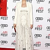 Natalie strategically threw a cream blazer over her Dior gown at the screening of Jackie at the AFI Fest.