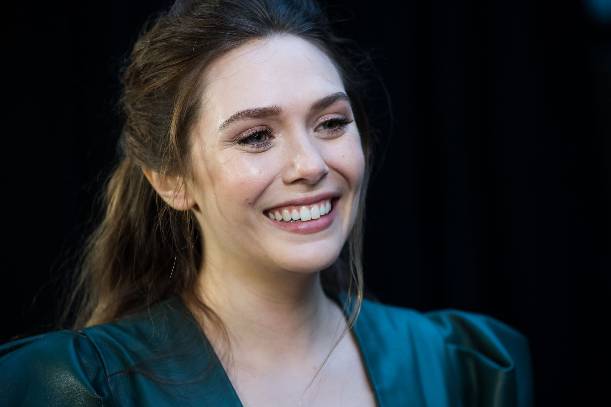 LONDON, ENGLAND - APRIL 08:  Elizabeth Olsen attends the UK Fan Event to celebrate the release of Marvel Studios' 'Avengers: Infinity War' at The London Television Centre on April 8, 2018 in London, England.  (Photo by Gareth Cattermole/Gareth Cattermole/Getty Images for Disney)