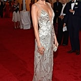 Camilla Belle played the '20s siren in a metallic beaded Ralph Lauren — complemented by a diamond bracelet, long pendant earrings, and a silver clutch — at the Met Gala.