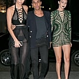 Gigi and Kendall stepped out for Olivier Rousteing's PFW dinner wearing sexy, strappy Balmain looks. We couldn't look away!