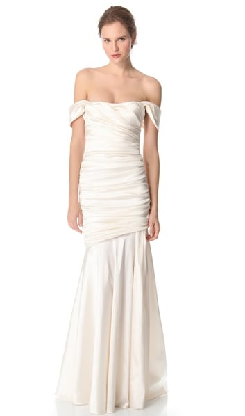 We love how the sleeves on this Theia off-the-shoulder gown ($995 ...