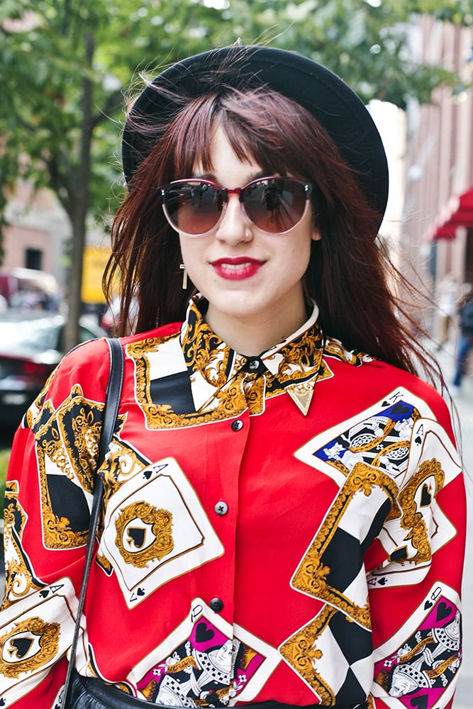 Red lips, reddish hair, and a red blouse? This woman proved that keeping it all in the color family makes for a smart beauty look. Photo by Caroline Voagen Nelson
