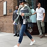 In October 2015, Jennifer styled a green jacket with straight jeans and white sneakers.