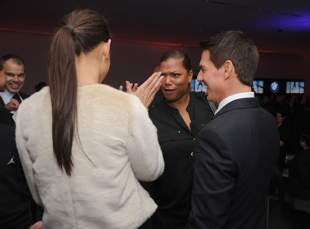 Katie Holmes gave Queen Latifah a high five, while Tom smiled.