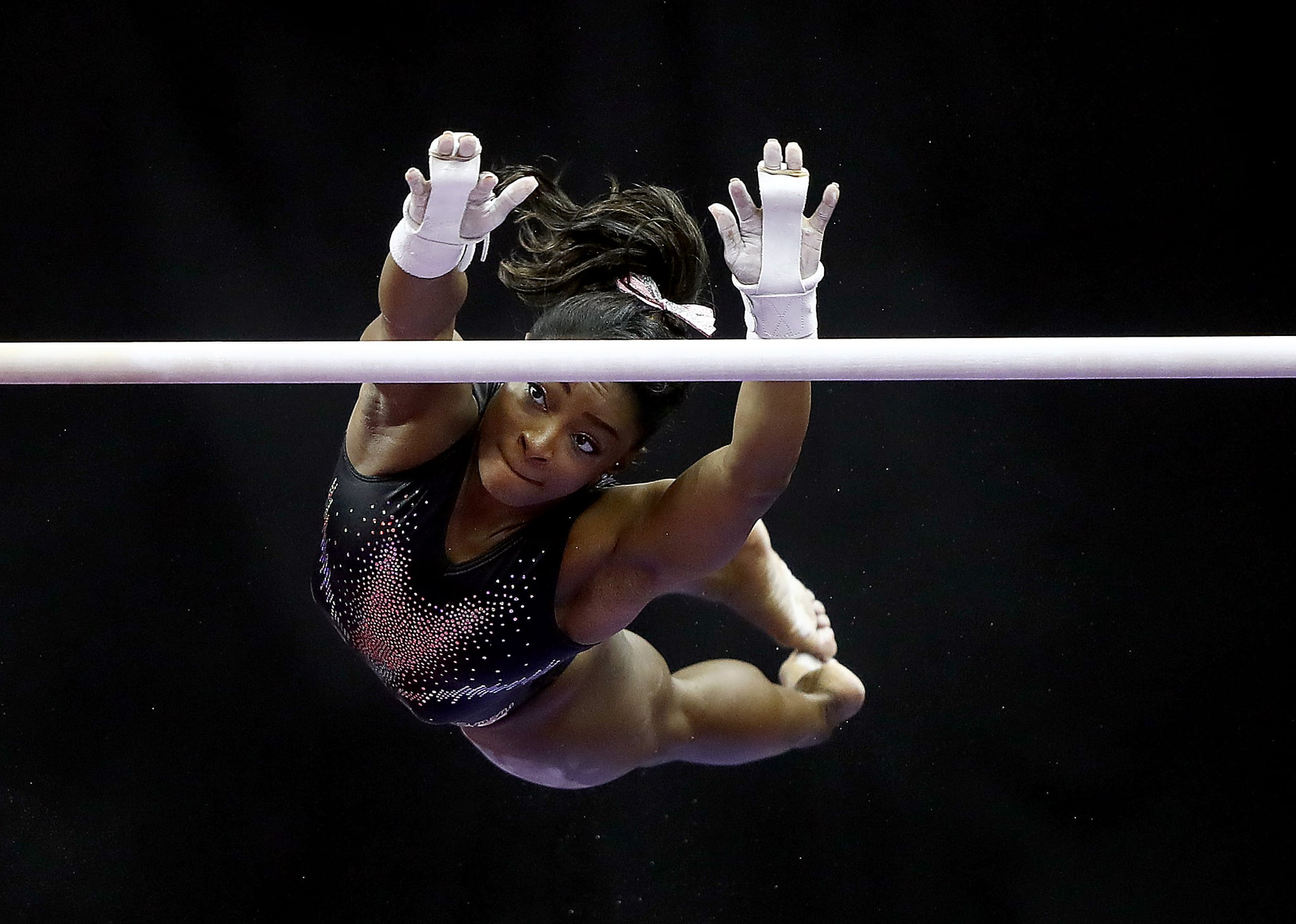 KANSAS CITY, MISSOURI - AUGUST 11:  Simone Biles warms up on the uneven bars prior to the Women's Senior competition of the 2019 U.S. Gymnastics Championships at the Sprint Center on August 11, 2019 in Kansas City, Missouri. (Photo by Jamie Squire/Getty Images)