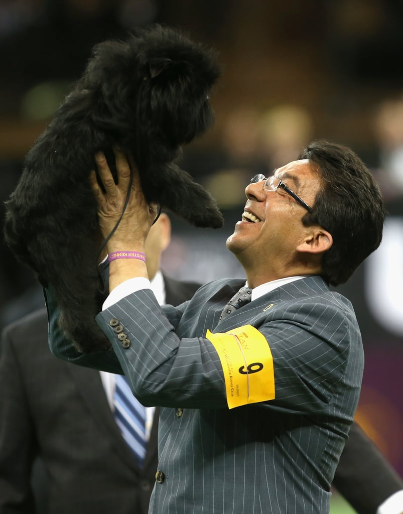 Handler Ernesto Lara held the top dog of the night.