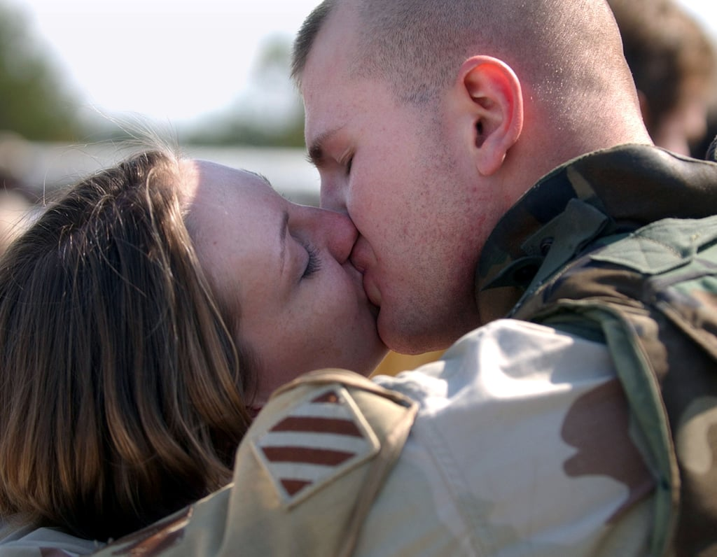 Sgt. William Frizzell kisses his wife, Amy, in February 2005, during a homecoming celebration for 150 soldiers from the Army's Third Infantry Division in Georgia.