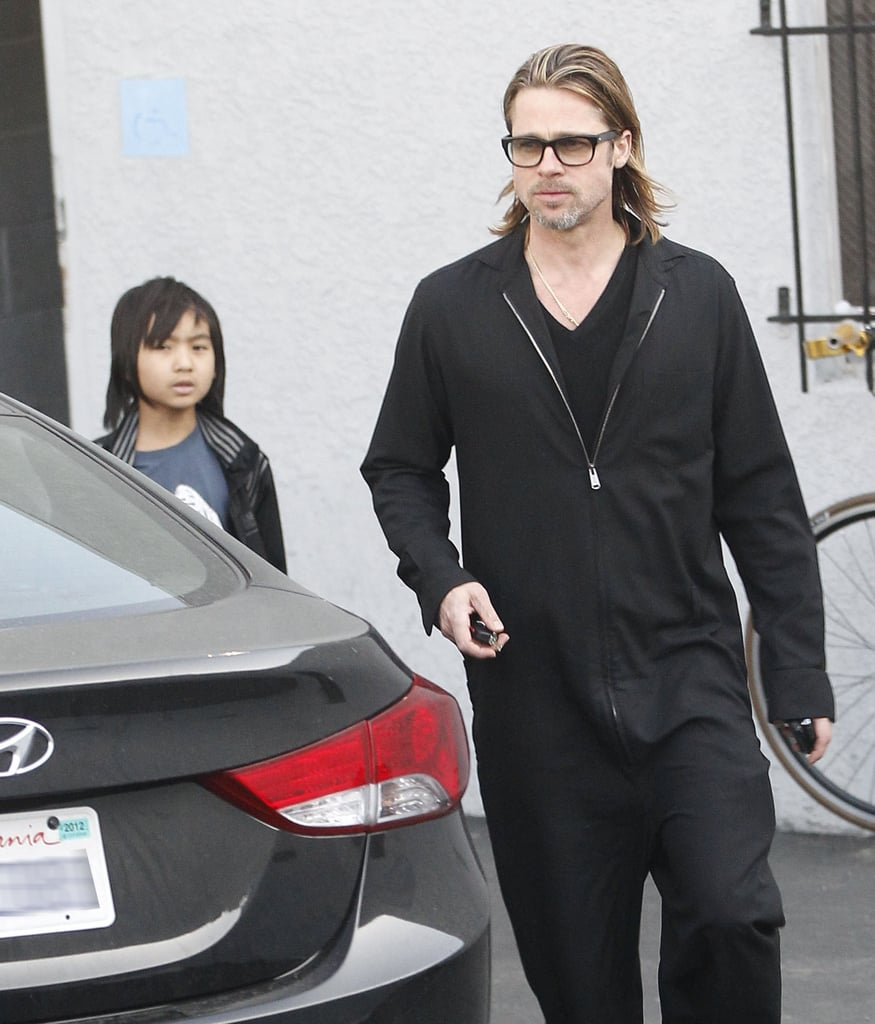 Brad Pitt and Maddox Jolie-Pitt stopped by the Guitar Center in LA in March.
