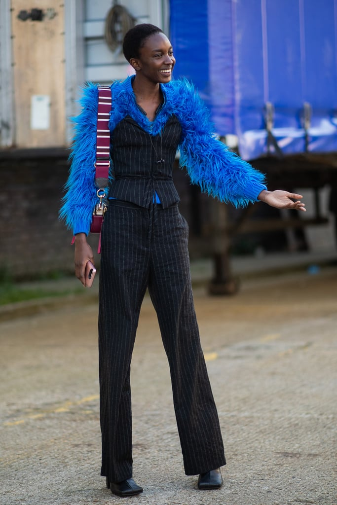 Why wear your furry jacket over your top when you can layer it underneath your structured bustier top for a look that's sure to turn heads.