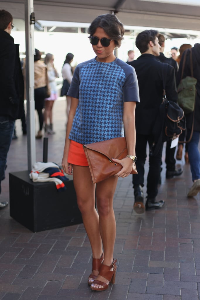 Look to this chic ensemble for sophisticated styling cues. Her boxy blue houndstooth top got an extra boost courtesy of her bold orange shorts — a fun color combo we've been loving lately.