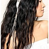 No festival would be complete without a touch of feathered fun, and this As Is Feather Hair Clip ($35) has some serious attitude.