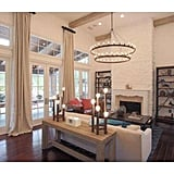 Open-beam ceilings and glass french doors allow natural light to fill the space.