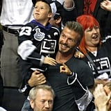 David Beckham cheered with Cruz Beckham in his arms at the LA Kings Stanley Cup final game in LA.