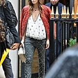 Jessica Biel wore a studded red leather jacket and leather pants for a shopping trip in Paris.