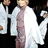 Nicole Richie threw a lab coat over her Julien MacDonald gown.