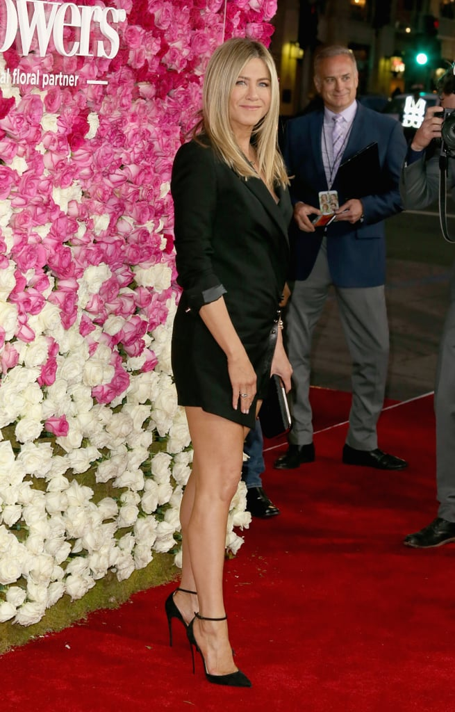 Jennifer Aniston attended the premiere of her latest film, Mother's Day, in LA on Wednesday, showing off a whole lot of leg. On top of flashing her megawatt smile, the actress looked to be in good spirits as she struck a handful of gorgeous poses for photographers on the red carpet. While Jennifer arrived solo, she linked up with former costar Bailee Madison, whom she starred alongside in 2011's Just Go With It, at the event. Although Jennifer's other half, Justin Theroux, wasn't in attendance, we did catch his supersexy outing over the weekend.  In the film, Jennifer plays a single mom named Sandy, whose ex-husband has just left her for a younger woman named Tina (played by Shay Mitchell). Keep reading for more of Jennifer, and then check out the trailer for the film before the movie hits theaters on April 29.