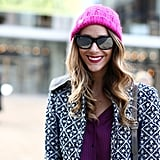 Matching your pink hat to your pink lipstick is always an ace choice.