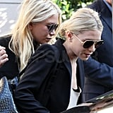 Mary-Kate and Ashley Olsen hopped into a black car.