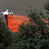 An air tanker dropped fire retardant on the Rim Fire.