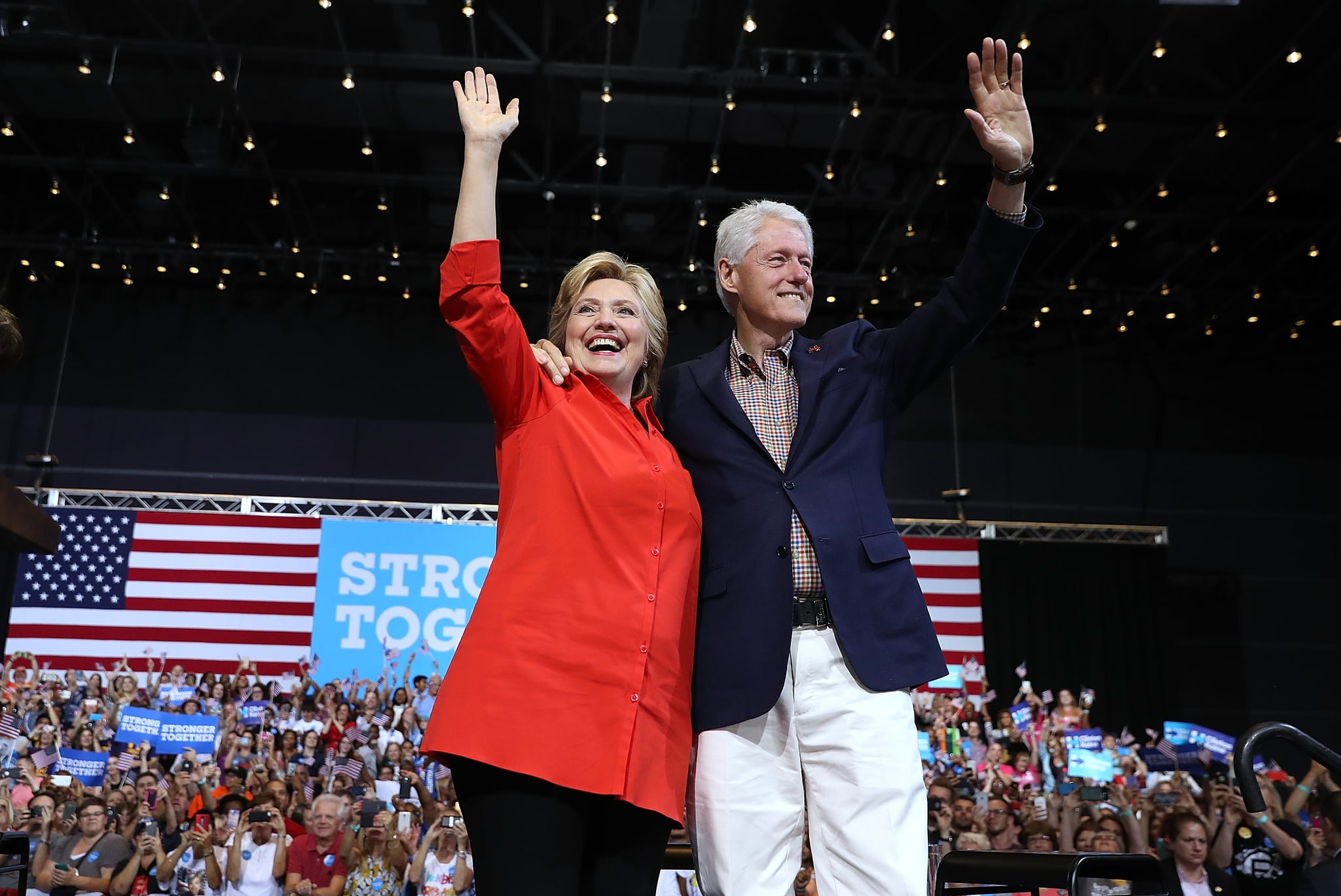 PITTSBURGH, PA - JULY 30:  Democratic presidential nominee former Secretary of State Hillary Clinton and her husband former U.S. president Bill Clinton greet supporters during a campaign rally with democratic vice presidential nominee U.S. Sen Tim Kaine (D-VA) at the David L. Lawrence Convention Center on July 30, 2016 in Pittsburgh, Pennsylvania. Hillary Clinton and Tim Kaine are continuing their three-day bus tour through Pennsylvania and Ohio.  (Photo by Justin Sullivan/Getty Images)