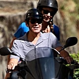 George Clooney and girlfriend Stacy Keibler enjoyed a scooter ride in Switzerland.