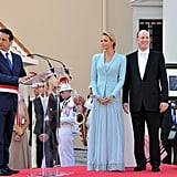 Princess Charlene of Monaco and Prince Albert II of Monaco listen to Georges Marsan, mayor of Monaco, deliver a speech for them.
