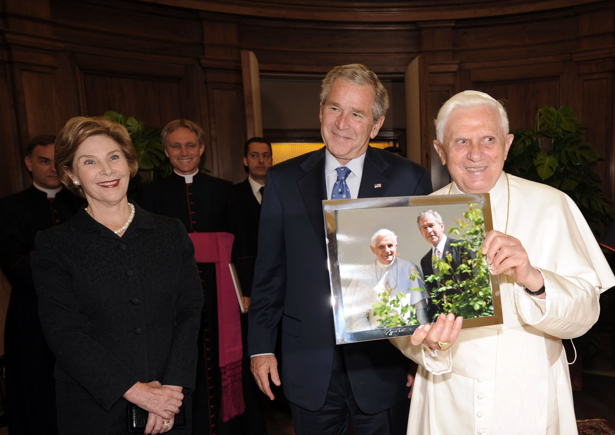 Pope Benedict XVI holds a picture while meeting with Bush and first lady Laura Bush June 13, 2008.