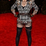 There was no such thing as too much punk for Madonna. The icon picked a Givenchy Haute Couture by Riccardo Tisci look that combined tartan, shredded fishnets, black leather, chains, and plenty of studs. Casadei ankle-strap pumps pulled in a pop of punky pink.