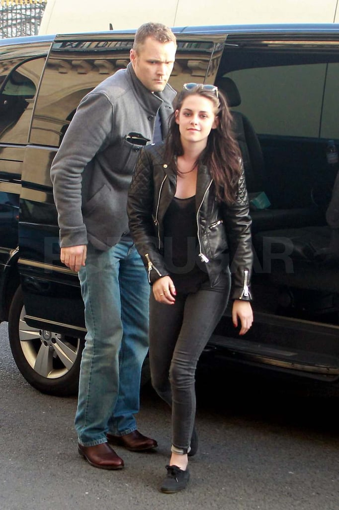 Kristen Stewart wore jeans and a black jacket to lunch at Le Duc in Paris this afternoon. She didn't waste any time changing into a more casual outfit after donning leather pants at the Balenciaga show. Kristen stepped out in the stylish look to attend the Paris Fashion Week runway presentation alongside Salma Hayek and Charlotte Gainsbourg. She arrived in France yesterday, after spending the weekend in LA with boyfriend Robert Pattinson. Kristen and Rob celebrated the Oscars together at the WME agency party, though in previous years they've separately attended Vanity Fair's bash.