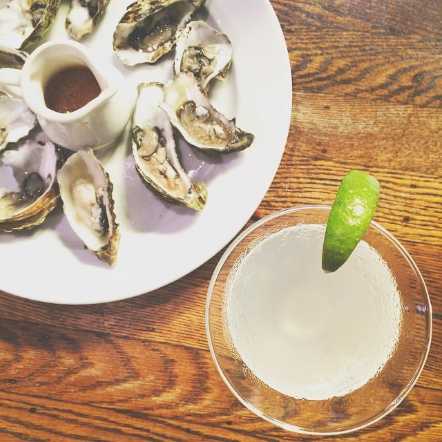 Eat oysters and sip on cocktails for happy hour.