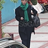 Julie Roberts in a black coat and green scarf in LA.